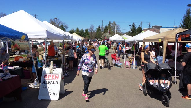 Loveland Farmer's Market vendors and patrons enjoyed a warm sunny opening day Tuesday, May 1 in Loveland