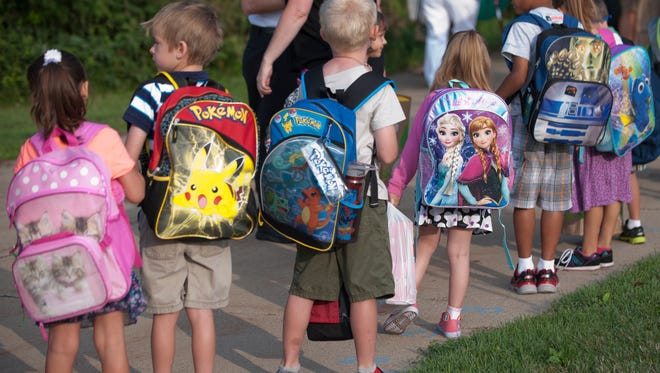 Children line up for the first day of school on Tuesday, Aug. 2, 2016 at Horizon Elementary School in Holt. Horizon Elementary and Sycamore Elementary School in Holt are on a balanced calendar and both started Tuesday.