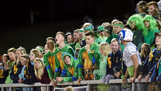 The Kennard-Dale student section wears green to raise awareness for mental health while watching a YAIAA football game Friday, Oct. 27, 2017, at Kennard-Dale. Susquehannock defeated Kennard-Dale 49-21.