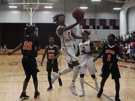 Madison County's Tre Adams slices through the paint