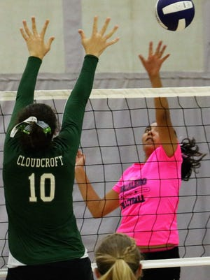 Mescalero's Katelyn Yuzos, right, tries to hit a ball past Cloudcroft's Laci Toddy on Thursday night.