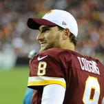 Washington Redskins quarterback Kirk Cousins watches from the sidelines against the Jacksonville Jaguars during the second half at FedEx Field.