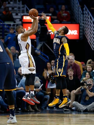 Indiana Pacers guard Monta Ellis (11) blocks a three-point attempt by New Orleans Pelicans guard Eric Gordon (10) in the final minute of the second half of an NBA basketball game in New Orleans, Friday, Jan. 8, 2016. The Pacers won 91-86. (AP Photo/Gerald Herbert)