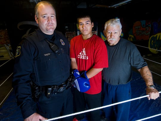 John Matthews (right) is a local barber and longtime boxing coach in Minnesota and Sioux Falls.