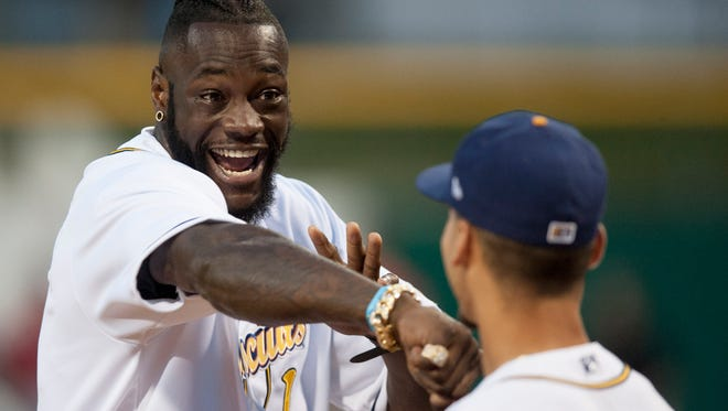 WBC Heavyweight Champion Deontay Wilder jokes with Andrew Velazquez as visits the Biscuits at Riverwalk Stadium in Montgomery, Ala. on Friday June 23, 2017.