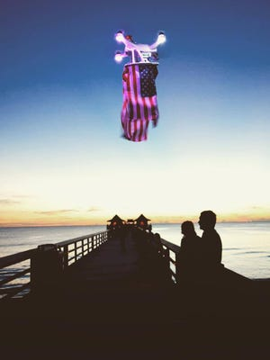 Juan Hinestrosa shared this photo of his flag-adorned drone that was flaying above the Naples Pier on Sept. 11, 2016.