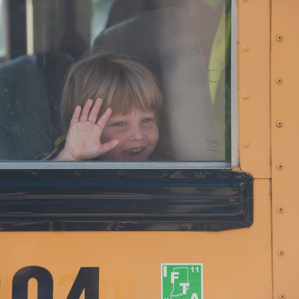 Jeremy Perlow, 5, takes the bus to day care at Temple Beth Shalom in Cherry Hill after his half day kindergarten class at Stockton School. Monday, September 15, 2014.