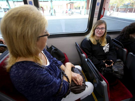 Cherriots bus passengers Deborah Stevens, left, and Kennedy Rosemoon talk as they make their way to Keizer on Tuesday, Sept. 8, 2015.
