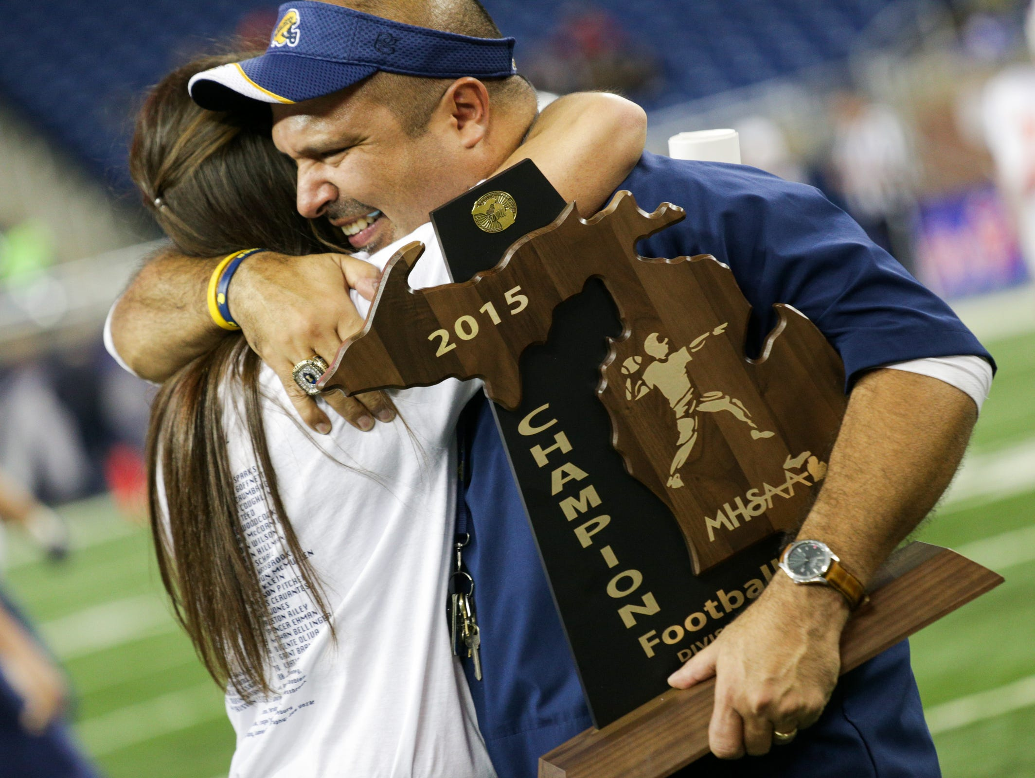 Ithaca coach Terry Hessbrook celebrates his state final win after defeating Clinton in the Division 6 final at Ford Field in Detroit on Friday, Nov. 27, 2015.