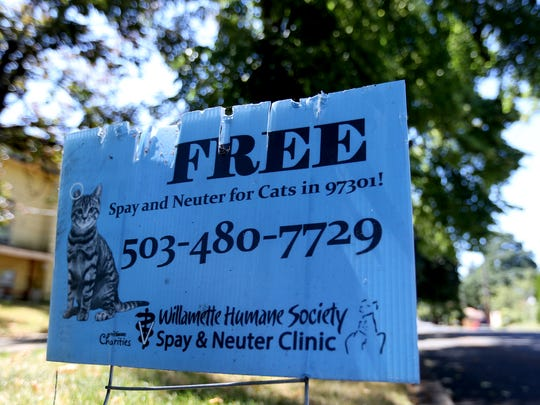 A yard sign advertising a free cat spay and neuter effort in the 97301 zip code of Salem. Photographed on Wednesday, July 13, 2016.