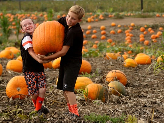 Friends E.J. Rubesh, 8, left, and Colin Cordle, 9,