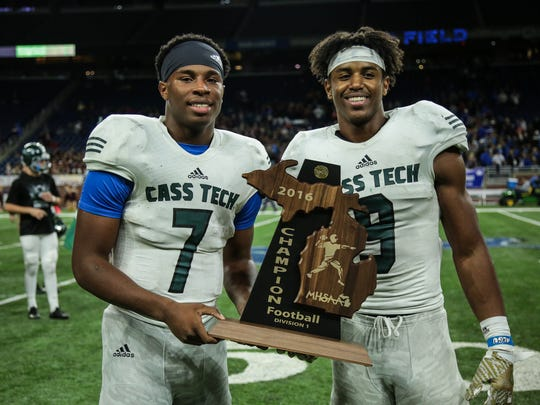 Detroit Cass Tech's Hall Rodney (7) and Donovan Peoples-Jones (9) with the trophy after winning the title against Detroit Catholic Central during the Division 1 High School Championship game on Saturday November 26, 2016, at Ford Field in Detroit, MI.