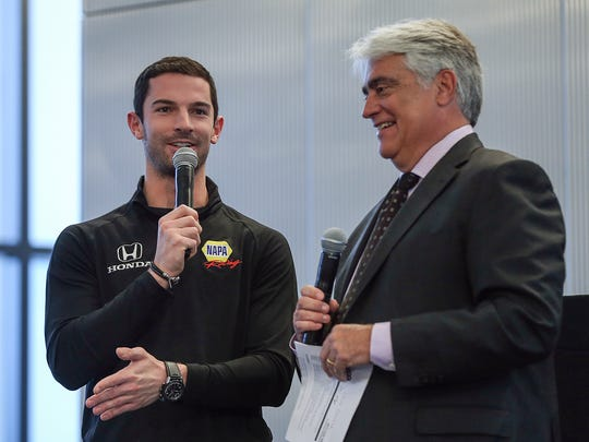 From left, Indianapolis 500 winner Alexander Rossi and Mark Miles prepare for the 2017 ticket design unveiling at Cummins distribution headquarters on East Market Street in downtown Indianapolis, Feb. 16, 2017.