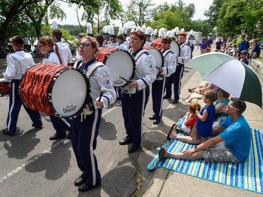 The Albany High School Marching Band performs during the Sartell SummerFest Parade Saturday, June 10, 2018 on Riverside Avenue in Sartell