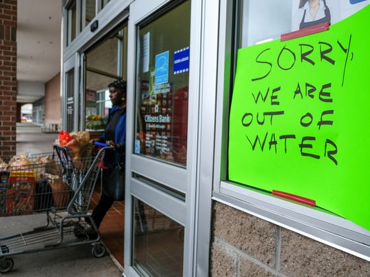 A sign states a Kroger in Novi is out of water as residents look for clean water on Tuesday October 24, 2017 after a boil advisory was issued following a water main break occurred in Farmington. The break has caused the advisory for 11 Oakland County communities.