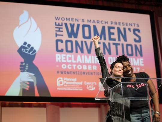 Rose McGowan hugs Tarana Burke, right, as she was being introduced to the stage during The Women's Convention at Cobo Center in downtown Detroit, Friday, October 27, 2017.