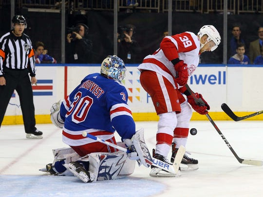 Rangers goalie Henrik Lundqvist (30) makes a save in front of Red Wings right wing Anthony Mantha (39) during the first period on Sunday, Feb. 25, 2018, in New York.