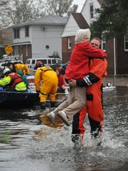 A firefighter, later identified as Sean Miick, carries