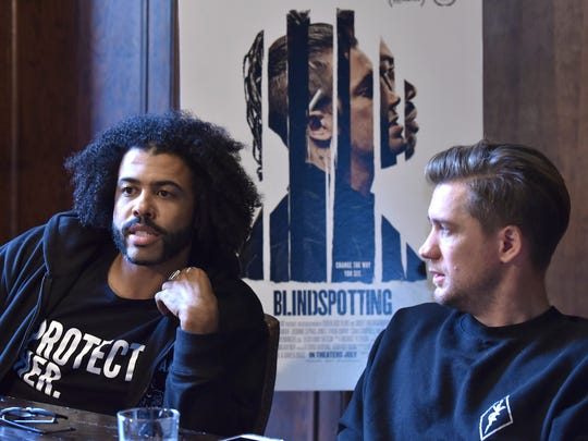 Blindspotting stars and writers Daveed Diggs, left, and Rafael Casal talk with a Detroit News reporter, Friday, June 8, 2018, about their movie that premiers July 27th. The movie is about the intersection of race and class, set against the rapidly gentrifying city of Oakland, CA. They talk in a private dining room at The Apparatus Room at the Detroit Foundation Hotel in downtown Detroit.