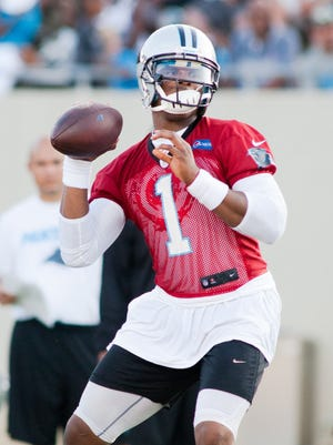 Panthers QB Cam Newton isn't hiding behind his red, non-contact jersey in practice.