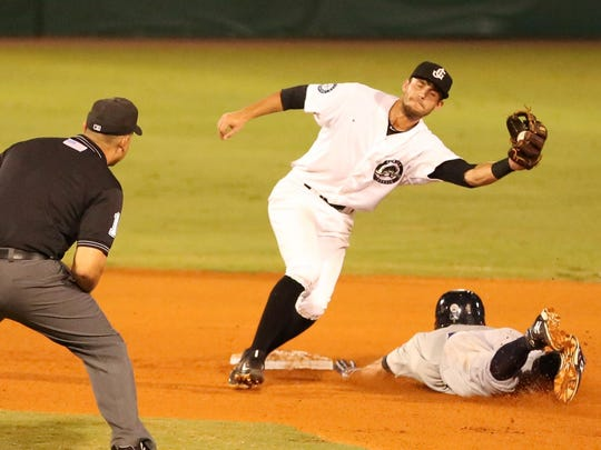 Jackson Generals shortstop Tyler Smith snags the catcher's throw Tuesday.