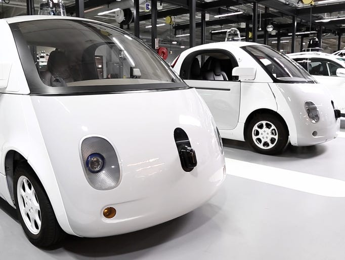 Google's self-drivign cars lined up at its headquarters
