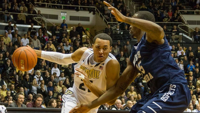 Purdue guard Kendall Stephens (21) dribbles the ball in on North Florida forward Chris Davenport (35) in the second half at Mackey Arena. The North Florida won 73-70.