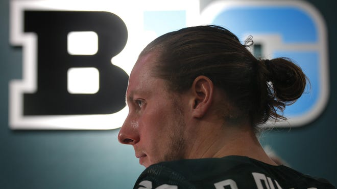 Michigan State linebacker Riley Bullough is interviewed during the team's NCAA college football media day, Monday, Aug. 10, 2015, in East Lansing, Mich. (AP Photo/Al Goldis)
