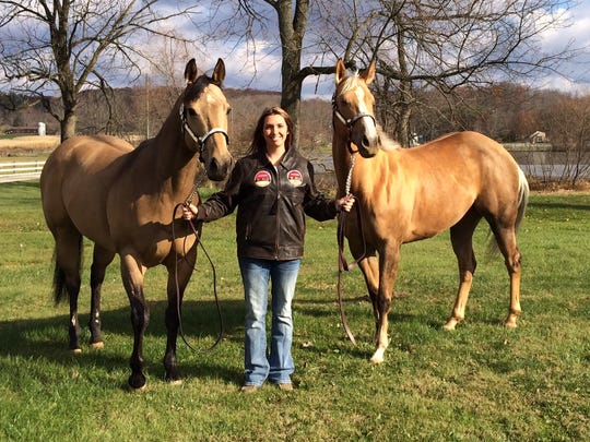 Valerie Vansickle-Watson won grand champion in amateur barrel racing at the American Quarter Horse Association World Championship in Oklahoma City with Seis So Sweet, left, and reserve champion in the same event with Dashing French Lady, right.