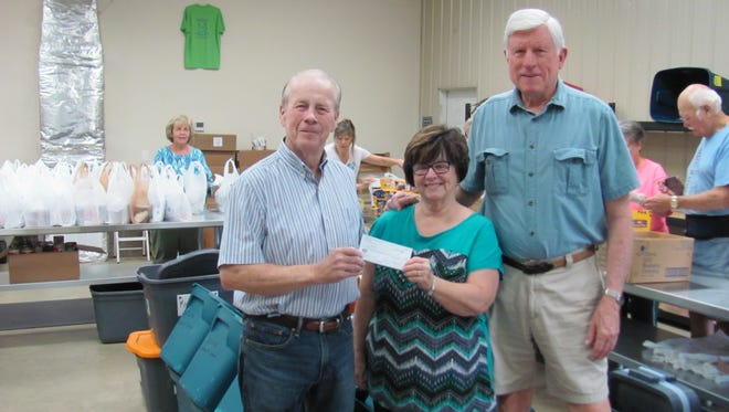 The Lake Norfork Striper Club recently donated $200 to the Mountain Home Back Pack 4 Kids program. The organization and its volunteers offer weekend meals to more that 250 children in the Mountain Home School District each. Program Coordinator Linda DeMass (center) accepted the donation from Lake Norfork Striper Club President John Gerard (left) and Very Berry, Treasurer of the Lake Norfork Striper Club.