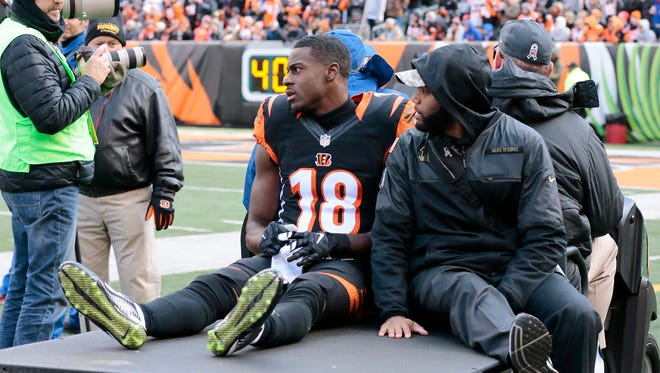 Cincinnati Bengals wide receiver A.J. Green (18) is carted off the field with a hamstring injury early in the first quarter of the NFL Week 11 game between the Cincinnati Bengals and the Buffalo Bills at Paul Brown Stadium in Cincinnati on Sunday, Nov. 20, 2016. At halftime the Bengals led 12-10.