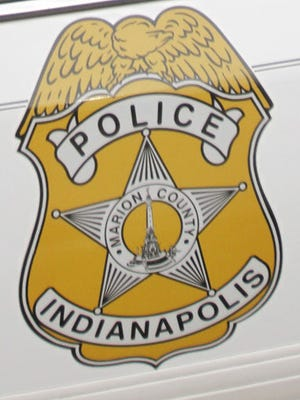 Badge for the Indianapolis Metropolitan Police Department is shown on patrol car.