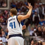 Apr 13, 2016; Dallas, TX, USA; Dallas Mavericks forward Dirk Nowitzki (41) celebrates making a three point basket against the San Antonio Spurs during the first quarter at the American Airlines Center. Mandatory Credit: Jerome Miron-USA TODAY Sports
