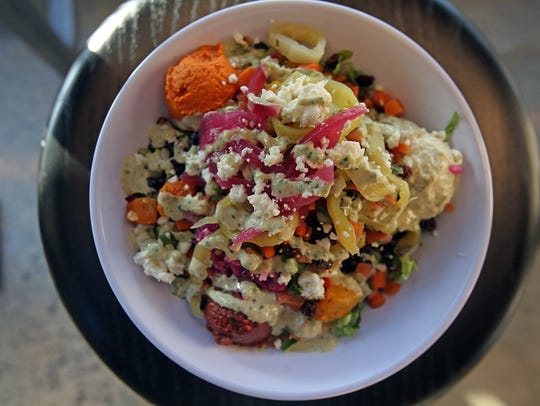 At Mediterranean fast-casual chain Cava, people can customize their salads, grain bowls and pitas.
