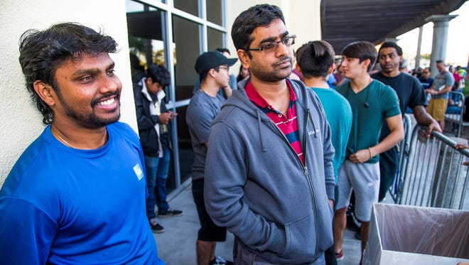 Sriram Ganesan (left) and Gopinathan Rathinavelu, both from Scottsdale, are the first two in line outside the Best Buy at 15449 N. Hayden Road, Scottsdale on Thanksgiving evening. They got in line at 8 p.m. Wednesday night in order to purchase a 50-inch Sharp 4K Smart television for $179.99.