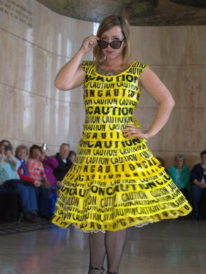 "Danielle Baca wears ""Caution Dress"" by Nancy Judd at Upcycle Oregon 2015. Upcycle Oregon is a free event promoting creative reuse through art, fashion and hands-on learning experiences 10 a.m. to 5 p.m. May 21 at Salem Convention Center."