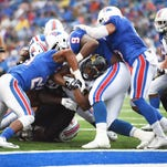University of Southern Mississippi running back Jalen Richard (30) searches for running room against Louisiana Tech defense at Joe Aillet Stadium on Saturday, Nov. 28, 2015.