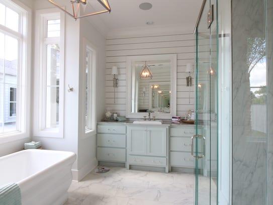 The gorgeous master bath has a spa-like feel.