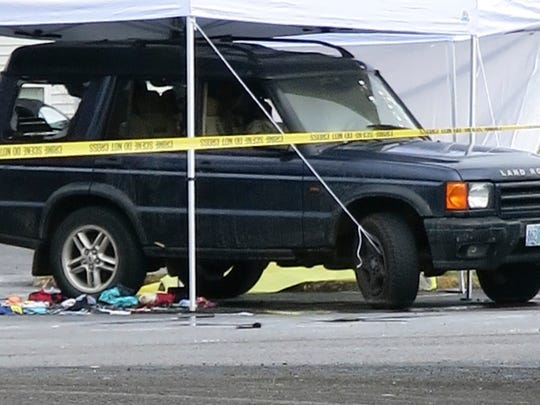 Police tape surrounds an vehicle after a shooting in Gresham, Wednesday, April 12, 2017.