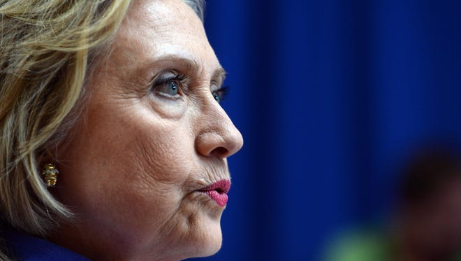 Democratic presidential candidate Hillary Clinton takes questions from reporters following a town hall meeting at Exeter High School on Aug. 10 in Exeter, New Hampshire. Clinton answered questions about Donald Trump's recent comments regarding women.