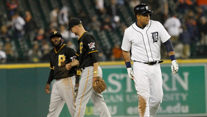 Detroit Tigers first baseman Miguel Cabrera walks off the field after being out at second base as part of a game ending double play as the  Pirates defeated the Tigers 5-4 in 14 innings on Tuesday, June 30, 2015.
