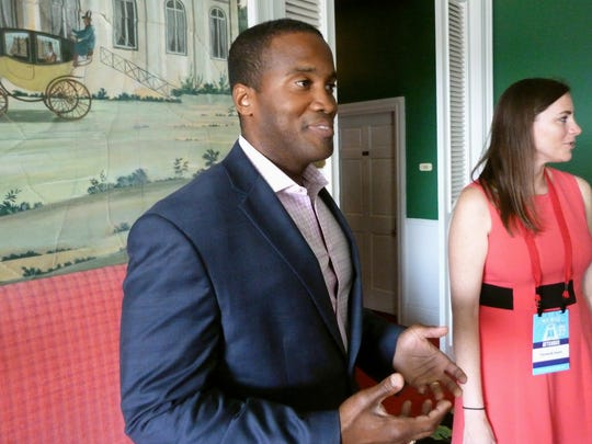 In this Sept. 23, 2017, file photo, John James speaks at the Mackinac Republican Leadership Conference on Mackinac Island, Mich. James, an Iraq War veteran and businessman, is seeking the GOP nomination to run against Democratic U.S. Sen. Debbie Stabenow in 2018. On Friday, May 4, 2018, James launched his first campaign ad that highlighted his military combat experience.