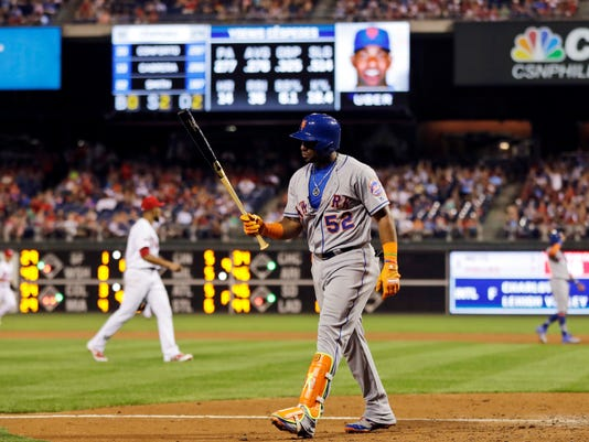 New York Mets' Yoenis Cespedes walks back to the dugout after striking out against Philadelphia Phillies relief pitcher Ricardo Pinto during the eighth inning of a baseball game, Saturday, Aug. 12, 2017, in Philadelphia. Philadelphia won 3-1. (AP Photo/Matt Slocum)