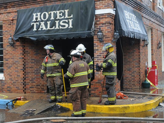 Firefighters stand outside the Hotel Talisi after extinguishing a blaze in the Tallassee hotel. Fire heavily damaged the Hotel Talisi and the Smarty Pants Consignment store Monday, Nov. 30, 2009. (Montgomery Advertiser, David Bundy)