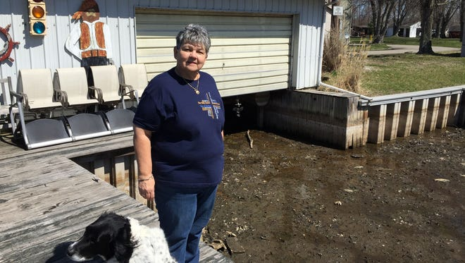 Sally Oldham grew up enjoying Buckeye Lake, but right now her two boats can't even make it out of the boathouse because it is just mud underneath.