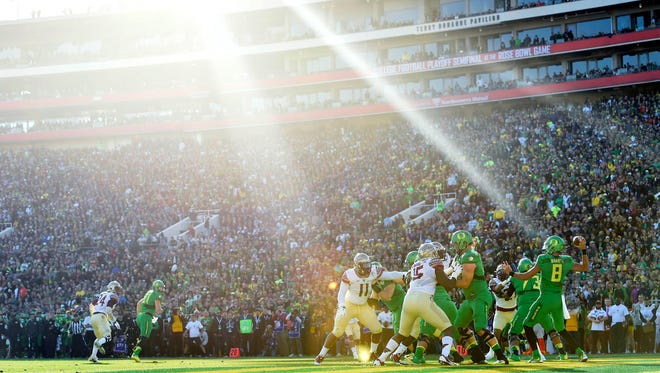 January 1, 2015; Pasadena, CA, USA; Oregon Ducks quarterback Marcus Mariota (8) throws from the end zone against the Florida State Seminoles in the 2015 Rose Bowl college football game at Rose Bowl. Mandatory Credit: Gary A. Vasquez-USA TODAY Sports