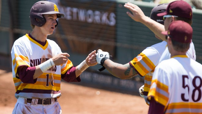 ASU's Johnny Sewald is congratulated after scoring against Oregon in the first inning during Pac-12 conference play at Packard Stadium in Tempe on May 11, 2014.