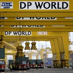 Cranes off load containers at the Jebel Ali port terminal 2 in Dubai, United Arab Emirates, in 2009. Port operator DP World said Nov. 13 it has reached a deal to buy the Dubai government-linked operator of free-trade zones in the Middle Eastern commercial hub for $2.6 billion.