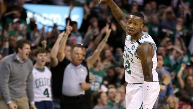Boston Celtics guard Terry Rozier  celebrates a three-pointer against the Philadelphia 76ers in  Game 1 of a second-round NBA playoff series Monday night.