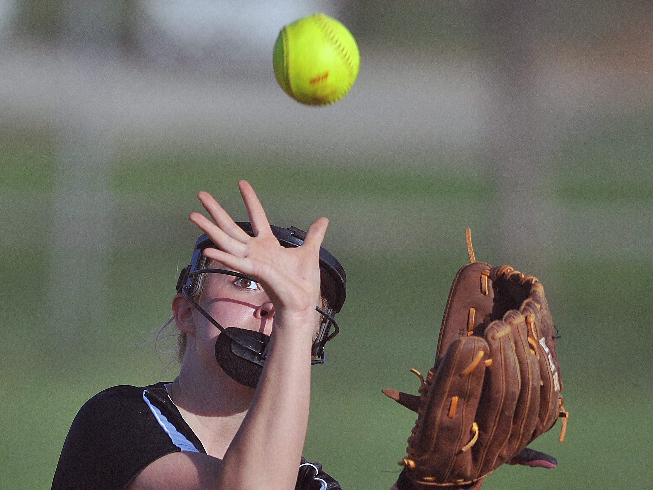 Lexington's Kailyn Conn makes a catch against Mount St. Dominic during the Wendy's Spring Classic at Brookside Park West Field No. 2 Friday.